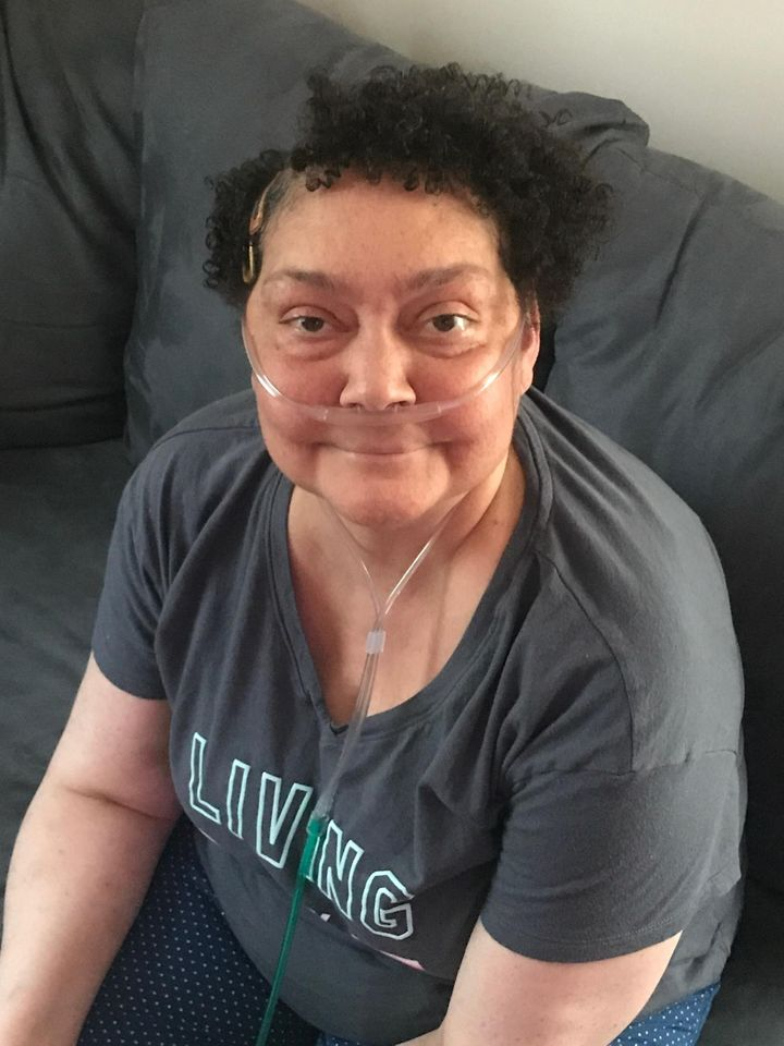 Arielle Reavis's mother, Dina Bailey, in late June. Bailey was hospitalized with coronavirus in May, but tested negative in June.