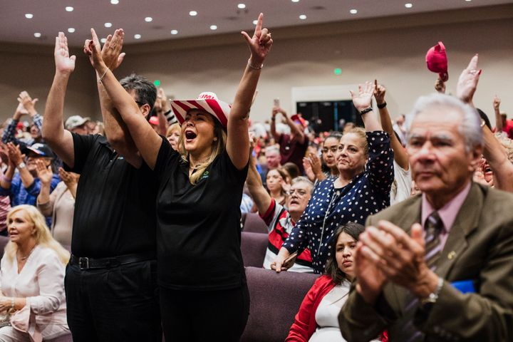 Attendees cheer as Trump addresses evangelicals at the Jan. 3 rally in Miami.