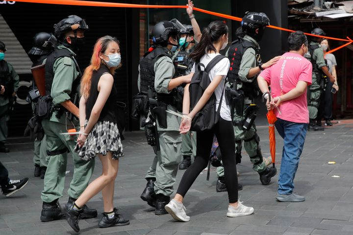 Police detain protesters after a protest in Causeway Bay before the annual handover march in Hong Kong, on July 1, 2020.&nbsp