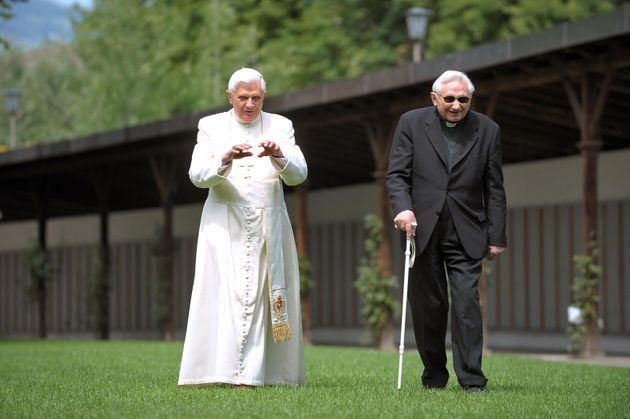 FILES - Picture taken on July 31, 2008 shows Pope Benedict XVI (L) as he walks with his brother Bishop...