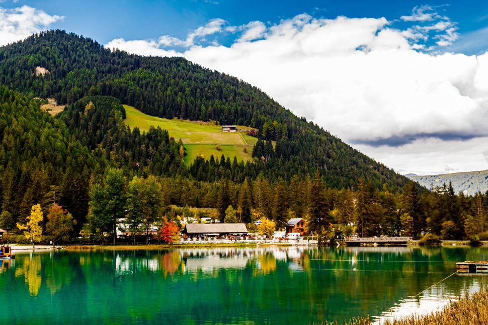 The Toblacher See is a lake in the municipality of Toblach in South Tyrol, Italy.