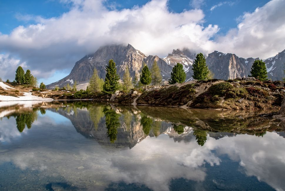 Mountains reflecting in Lago di Limides, South Tyrol on a spring morning