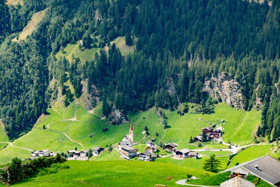 Panoramic view from the Timmelsjoch high alpine road in Texelgruppe to village of Moos in Passeier region,  Oetztal Alps, South Tyrol, Italy