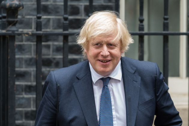 British Prime Minister Boris Johnson leaves 10 Downing Street for PMQs at the House of Commons on 01...