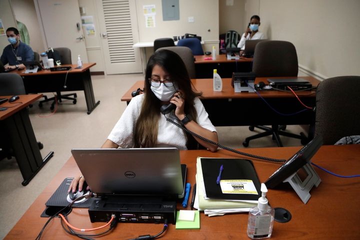 Maria Fernanda works on COVID contact tracing at the Florida Department of Health in Miami-Dade County in Doral, Florida, in