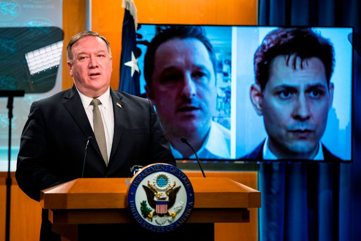 Michael Spavor, a Canadian businessman and Michael Kovrig, right, a former Canadian diplomat, detained in China since December 2018, are shown on a video monitor as U.S. Secretary of State Mike Pompeo, speaks during a news conference at the State Department on July 1, 2020, in Washington.