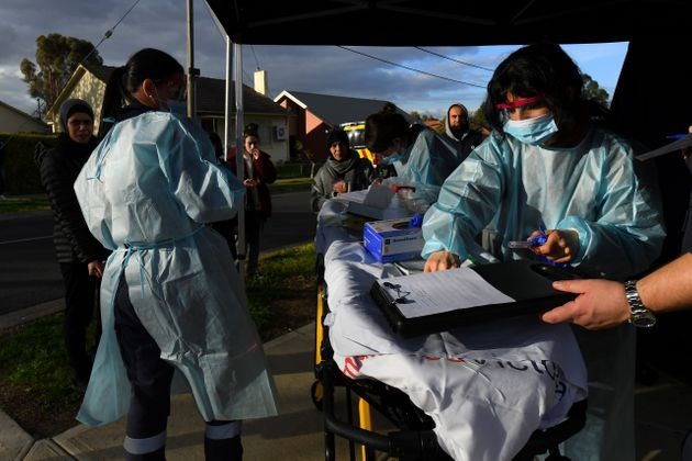 Medical professionals work with members of the public at a pop-up coronavirus disease. AAP Image/James...