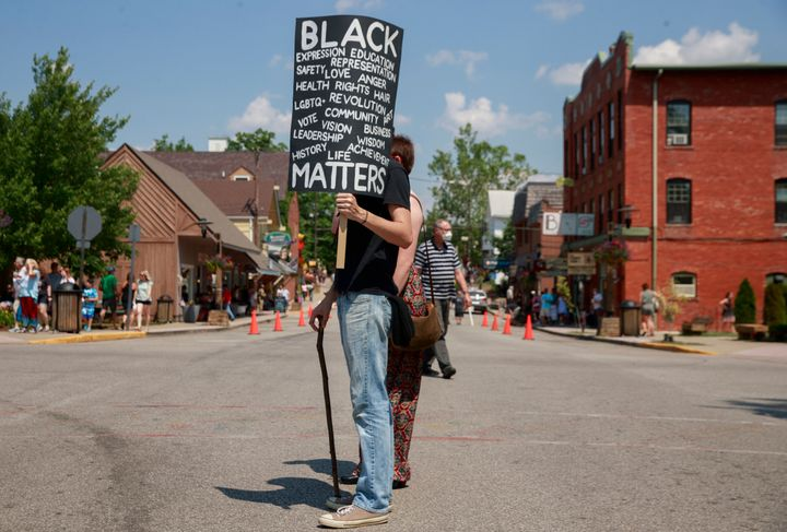 A man holds a placard during a demonstration in solidarity with Black Lives Matter in Nashville, Indiana, onJune 20. Na