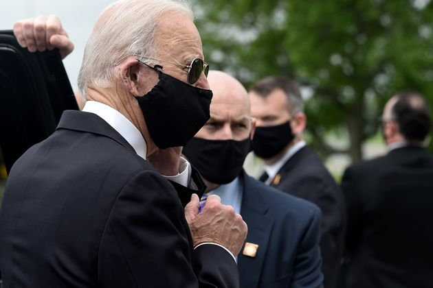 Joe Biden wore a black face mask while paying respects to fallen service members on Memorial Day in New...