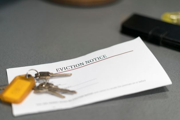 House keys sitting on an eviction notice received in the