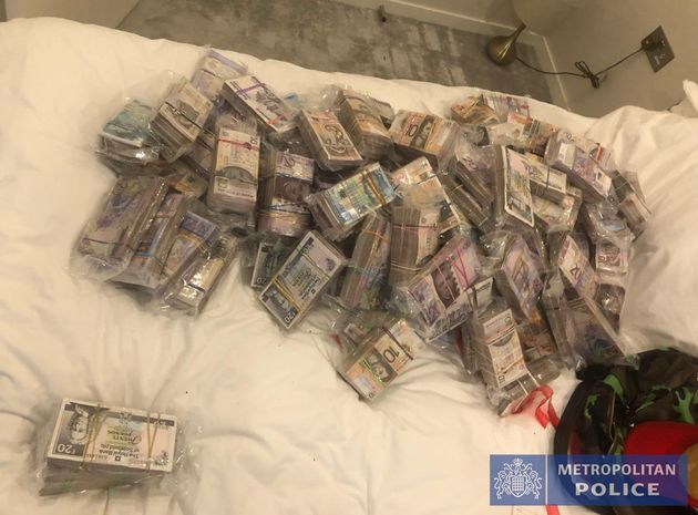 Undated handout photo issued by the Metropolitan Police of a quantity of cash seized by officers in Operation