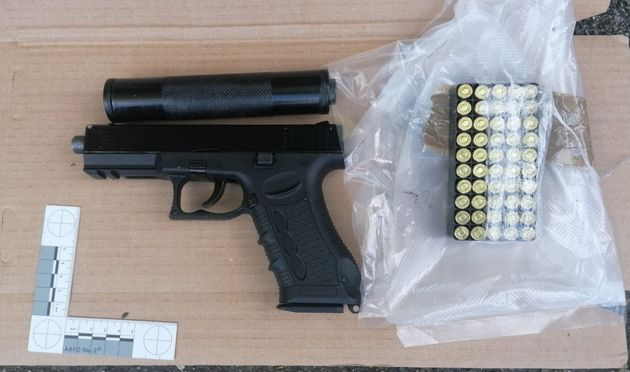 Undated handout photo issued by the Metropolitan Police of a firearm and ammunition seized in Operation