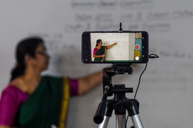 A school teacher gives an online class at a government school in Chennai on June 3,