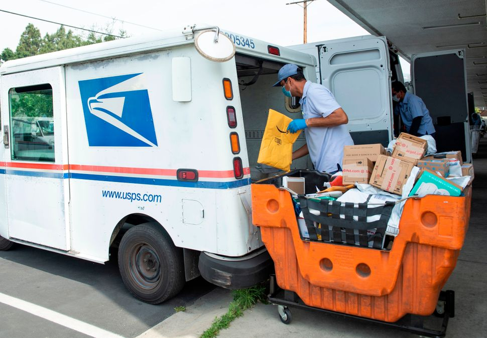 Mail carrier Oscar Osorio delivers mail and packages in the Los Feliz community of Los Angeles on April