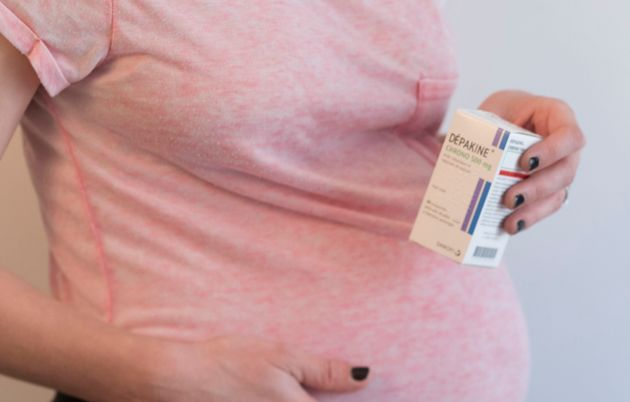 Pregnant woman holding a box of Depakine, Valproic Acid, used to treat seizures. (Photo by: BSIP/Universal...