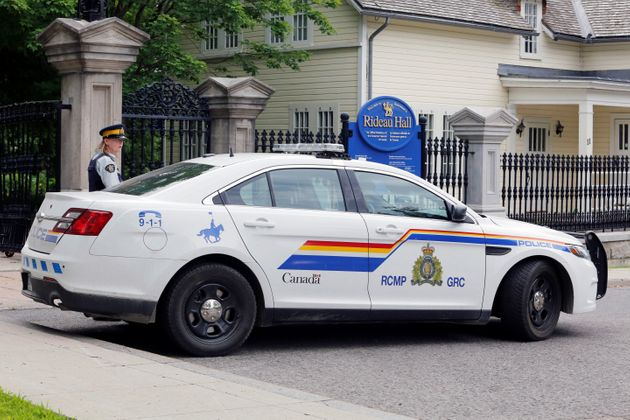 A police officer guards the front gate to Rideau Hall in Ottawa after an armed man was apprehended on...