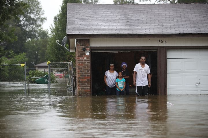 People in Houston wait to be rescued from their flooded homes after the area was inundated by Hurricane Harvey on Aug. 28, 2017.