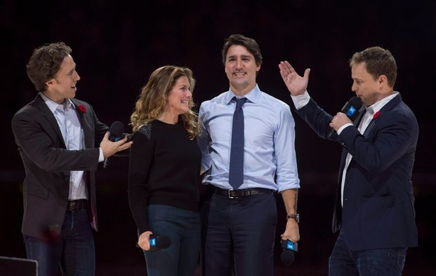 Craig (left) and Marc Kielburger introduce Prime Minister Justin Trudeau and his wife Sophie Gregoire-Trudeau...