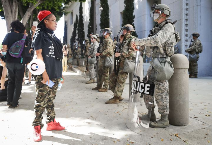 A protester looks at National Guard troops posted in Los Angeles on June 3. Jackson was among their ranks.