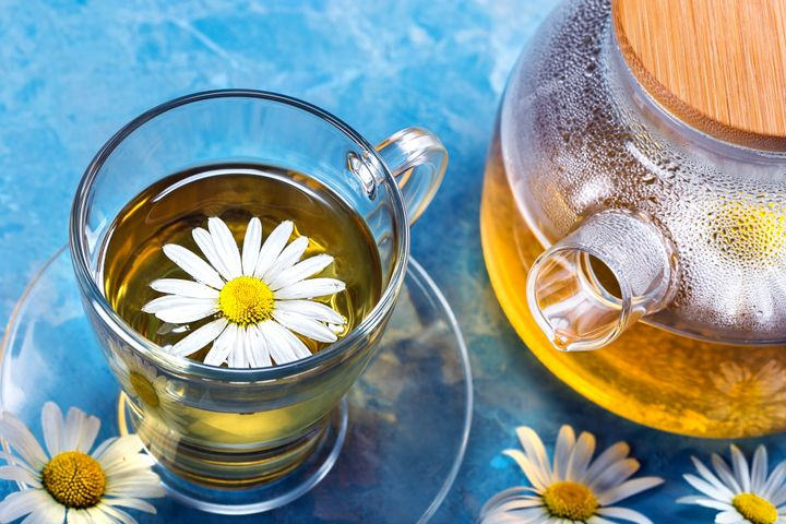 Chamomile tea. Cup and teapot with tea.