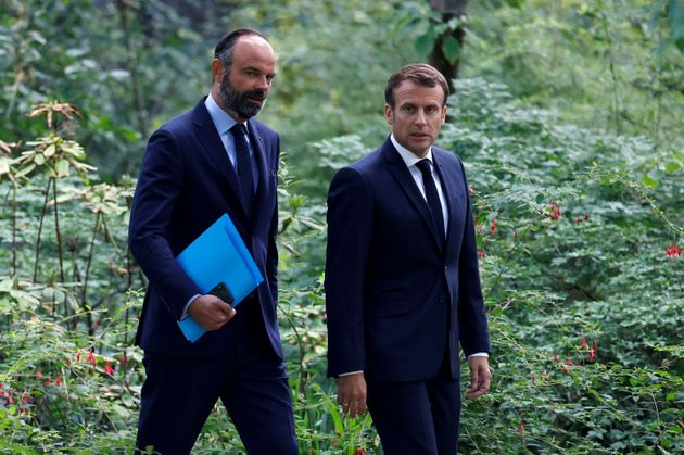 French President Emmanuel Macron (R) and French Prime Minister Edouard Philippe (Photo by CHRISTIAN...