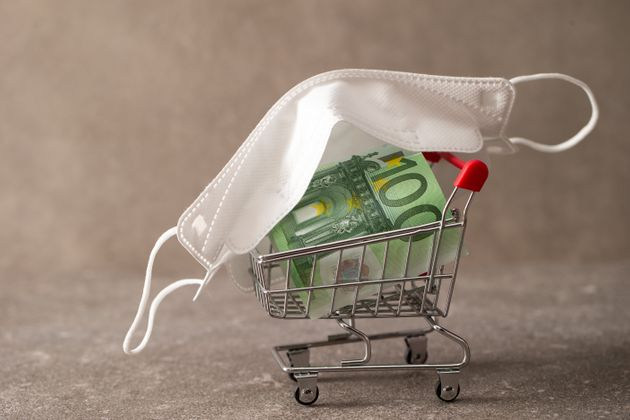 Euro banknote with shopping cart and face