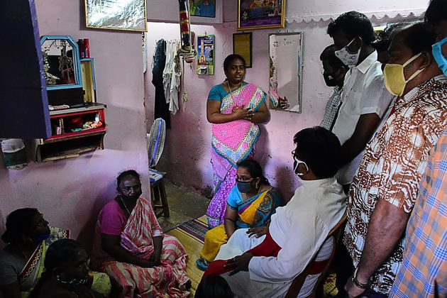 A church priest consoles family members of Jayaraj and Bennix in Thoothukudi district on June 28,