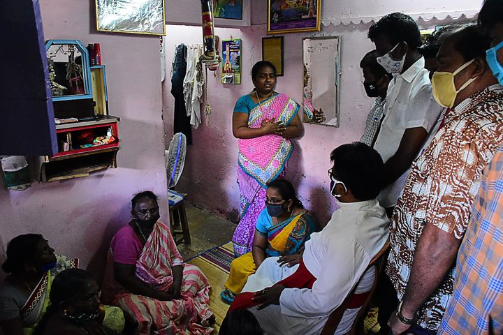 A church priest consoles family members of Jayaraj and Bennix in Thoothukudi district on June 28, 2020.