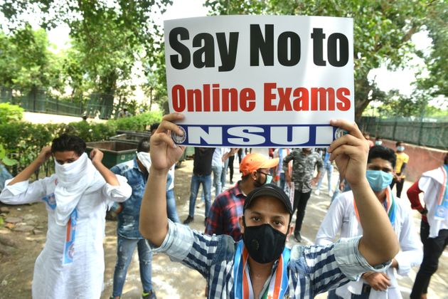 NSUI members protest for cancellation of University exams and promotion of all students in New
