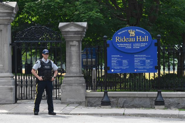 A police officer stands by a fence outside Rideau Hall in Ottawa on