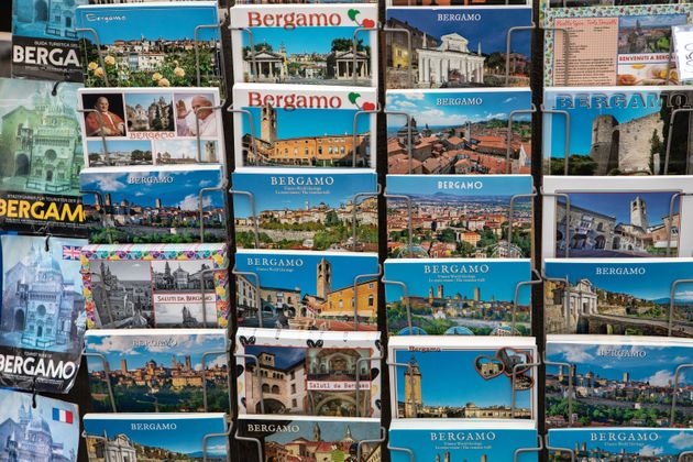 BERGAMO, ITALY - JUNE 18: Some local postcards of Bergamo on display for sale at a souvenir shop on June...