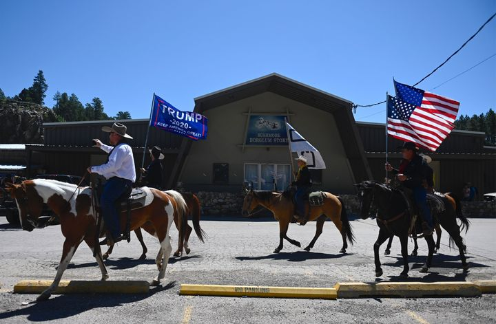 Supporters of US President Donald Trump ride through Keystone, South Dakota, on July 3, 2020, before a fireworks celebration