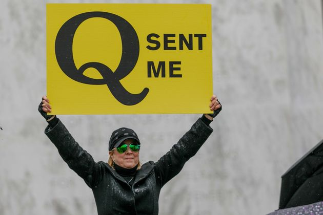 A QAnon conspiracy theorist demonstrates at an anti-quarantine protest in Salem, Oregon, on May
