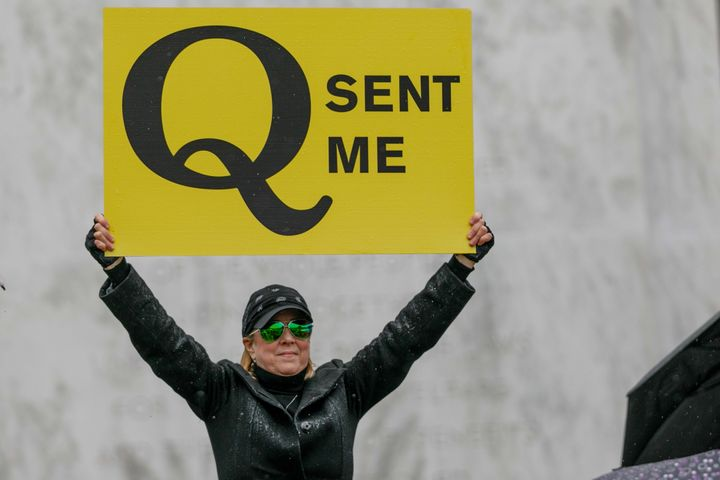 A QAnon conspiracy theorist demonstrates at an anti-quarantine protest in Salem, Oregon, on May 2.