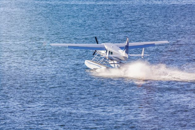 A seaplane landing on water in