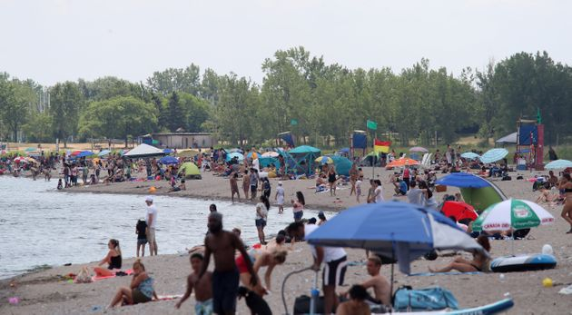 People gather at the Beaches as temperature soar in Toronto on