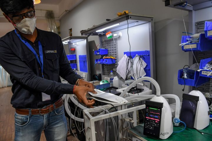 In this photo taken on March 25, 2020, AgVa Healthcare employee Vaibhav Gupta demonstrates using a ventilator at the research and development (R&D) centre in Noida in Uttar Pradesh state.