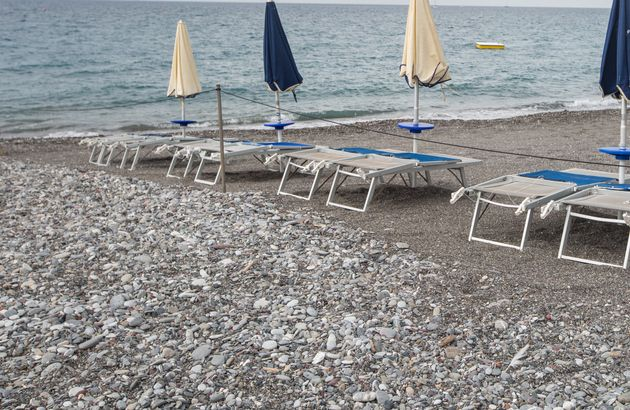 Empty sunbeds and closed sun umbrellas, in Lavagna, Italy, on August 12, 2019. As the weather was cloudy...