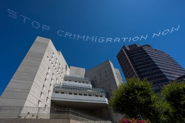 "The skytyped phrase, ""STOP CRIMMIGRATION NOW,"" chosen by artist Bobby Salcedo is seen over the LA Field Office during th"