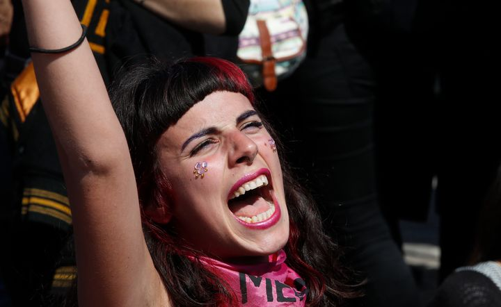 A woman shouts during a march to protest the World Congress of Families, in Verona, Italy, Saturday, March 30, 2019. A congress in Italy under the auspices of a U.S. organization that defines family as strictly centering around a mother and father has made Verona — the city of Romeo and Juliet — the backdrop for a culture clash over family values, with a coalition of civic groups mobilizing against what they see as a counter-reform movement to limit LGBT and women's rights. (AP Photo/Antonio Calanni)