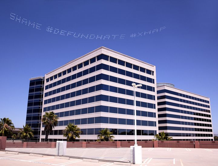 "The skytyped phrase ""#SHAME #DEFUND HATE"" chosen by artist Cassils is seen over the Geo Group Headquarters during the In Plai"