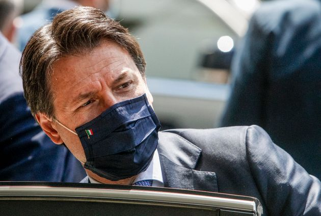 Italy's Premier Giuseppe Conte leaves after attending a thanksgiving ceremony dedicated to physicians...