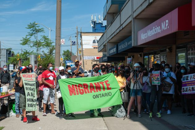 Demonstrators gathered in front of Immigration Minister Marco Mendicino's office in Toronto after the...