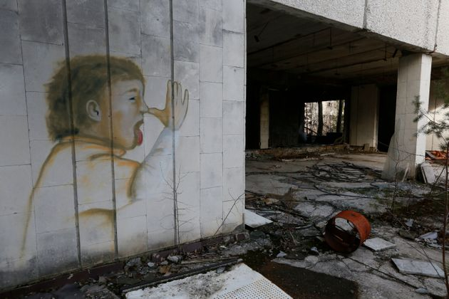 Graffiti depicts a child on the wall of the former supermarket in the deserted town of Pripyat, some...