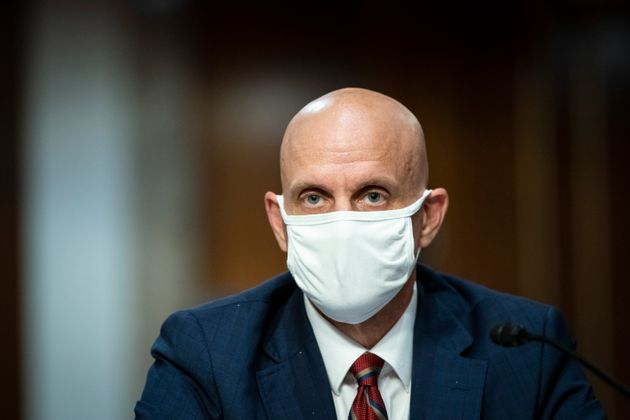 Dr. Stephen Hahn wears a face mask during a Senate hearing in Washington on June