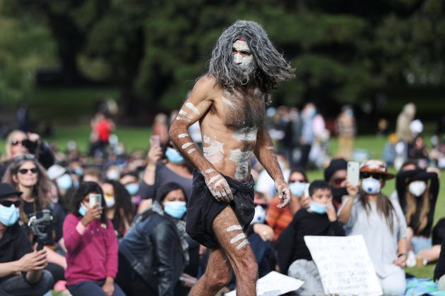 An Indigenous man takes part in a demonstration calling for an end to police brutality against Black...