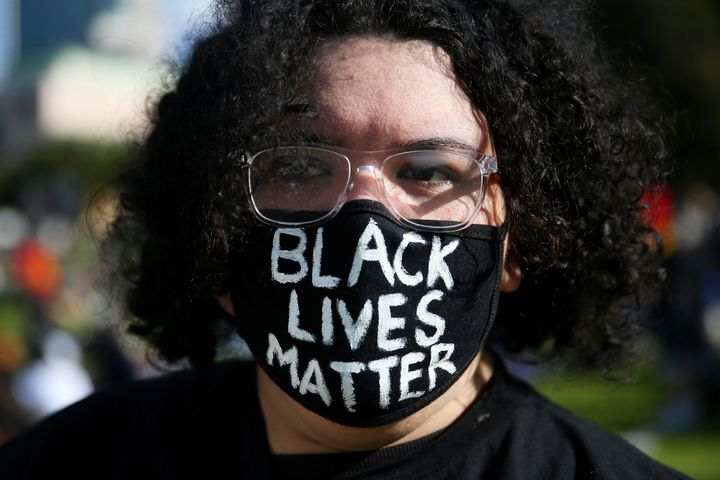 SYDNEY, AUSTRALIA - JULY 05: A woman looks on during a rally against Black Deaths in Custody in The Domain on July 05, 2020 in Sydney, Australia.The rally was organised to protest against Aboriginal and Torres Strait Islander deaths in custody and in solidarity with the global Black Lives Matter movement. (Photo by Don Arnold/Getty Images)