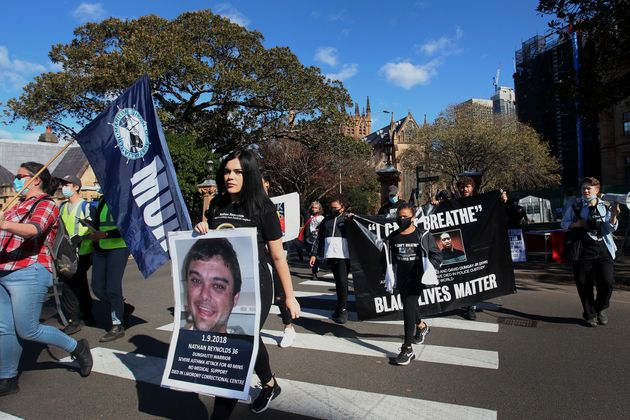 SYDNEY, AUSTRALIA - JULY 05: Activists walk towards The Domain to rally against Aboriginal and Torres...