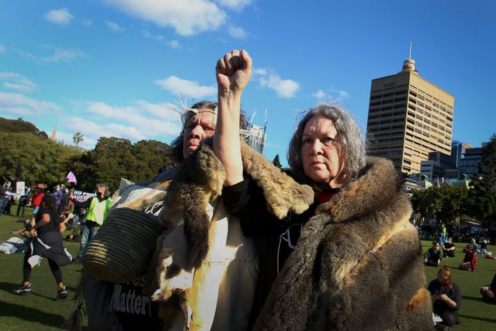 SYDNEY, AUSTRALIA - JULY 05: Aboriginal elders raise their arms towards the sky during a rally against Aboriginal and Torres Strait Islander deaths in custody in The Domain on July 05, 2020 in Sydney, Australia. Since the Royal Commission into Aboriginal deaths in custody ended in 1991 there have been over 400 deaths. Rallies have been organised across the country in solidarity with the global Black Lives Matter movement. (Photo by Lisa Maree Williams/Getty Images)
