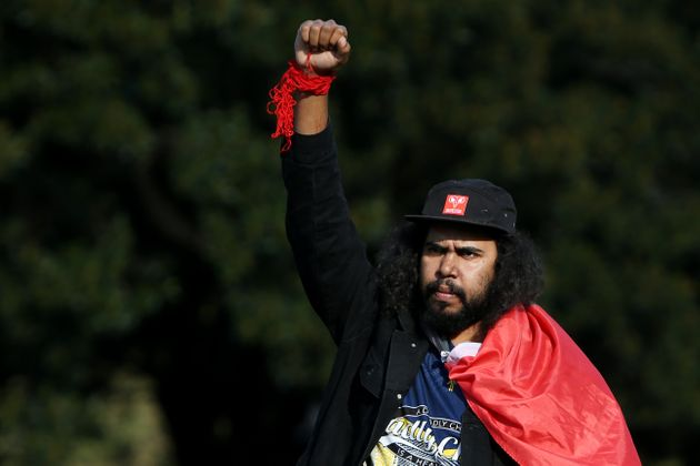 SYDNEY, AUSTRALIA - JULY 05: A protester raises his arm in the air during a rally against Aboriginal...